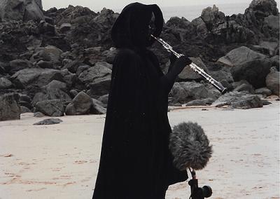 Masked Oboe Performer