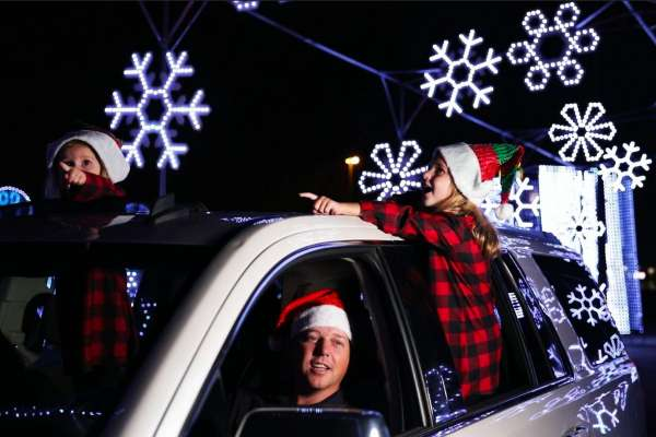 Family at Drive through holiday lights