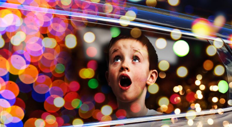 Child looking at holiday lights