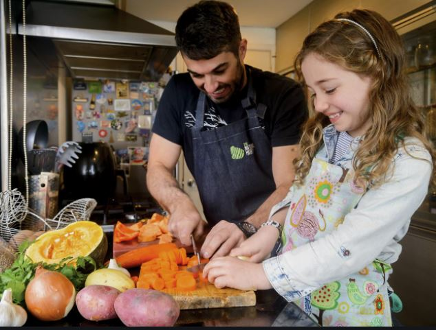 Father and daughter cooking healthy