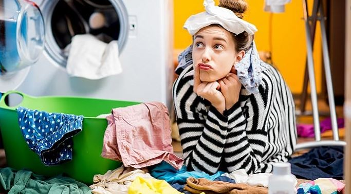 Woman Buried in Laundry