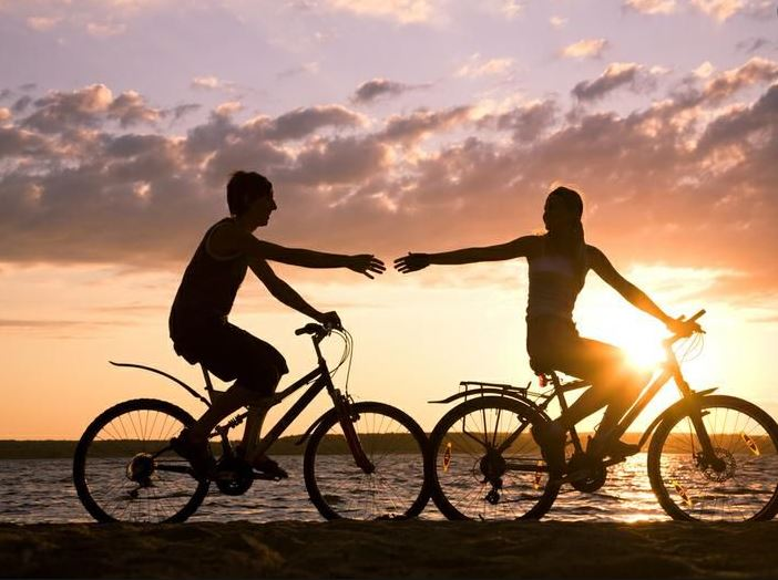 Couple bicycling together